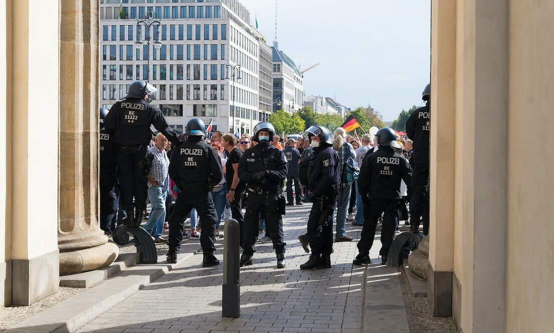 Berlin police break up weekend protest and open arson investigation