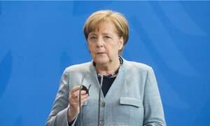 Angela Merkel returns to office after 14 days in quarantine